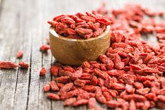 Dried goji berries. Dried goji berries in bowl on wooden background royalty free stock image
