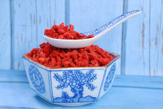 Dried goji berries on chinese spoon and in a bowl Stock Image