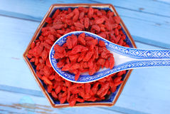 Dried goji berries on chinese spoon and in a bowl Stock Images