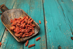 Dried goji berries in rustic wooden spoon Royalty Free Stock Image