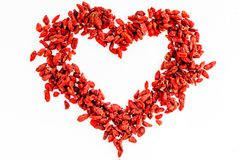 Dried goji berries in heart shape on white background top view copyspace pattern royalty free stock photos
