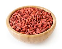 Dried goji berries in wooden bowl isolated on white Stock Photo