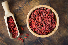 Dried goji berries in wooden bowl Royalty Free Stock Image