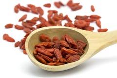 Dried Goji berries in wooden spoon Stock Image