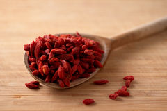 Dried goji berries on the wooden spoon Royalty Free Stock Images