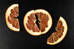 Dried grapefruit on black background Royalty Free Stock Images