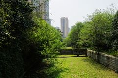 Dried grassy riverway in city at sunny spring noon. Dried grassy river bed in the city at sunny spring noon,Chengdu,China Royalty Free Stock Photography