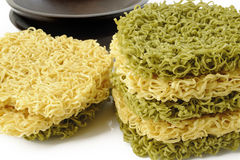 Dried green noodles and dried noodles on white Stock Photo