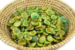 Dried green pea in basket Royalty Free Stock Photos