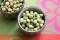 Dried green peas. Some dried green peas in a bowl royalty free stock images