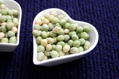 Dried green peas. Some dried green peas in a bowl stock photography
