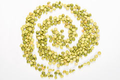 Dried green peas in a spiral shape. Royalty Free Stock Photo
