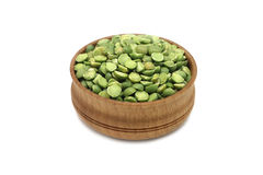 Dried green peas in a wooden bowl Stock Image