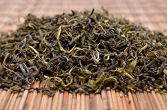 Dried green tea on the background Royalty Free Stock Images