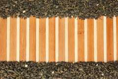 Dried  green tea  on a bamboo mat Royalty Free Stock Photo