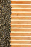 Dried  green  tea  on a bamboo mat Royalty Free Stock Photography