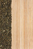Dried  green  tea  on a bamboo mat Royalty Free Stock Photos