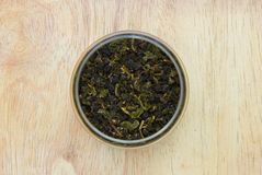 Dried green tea in glass jar Royalty Free Stock Image