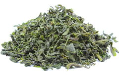 Dried green tea leaves. On white background Royalty Free Stock Photo