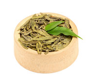 Dried green tea leaves in a wooden bowl. Royalty Free Stock Image