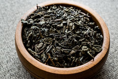 Dried Green Tea Leaves in wooden bowl. Stock Images