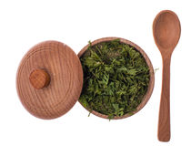 Dried and ground celery greens in a wooden jar. Studio Photor Stock Image