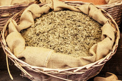 Dried ground fenugreek in the wicker basket Royalty Free Stock Photo