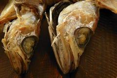 Dried hake fish over wood Stock Photos