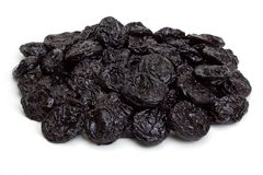 Dried handful of black prunes. Isolated on white stock photos