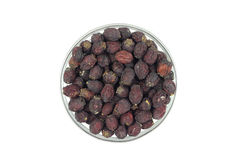 Dried hawthorn berries in a glass Royalty Free Stock Images