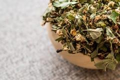 Dried Hawthorn / Crataegi folium flore in wooden ladle. Organic concept stock image