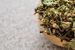 Dried Hawthorn / Crataegi folium flore in wooden ladle. Organic concept royalty free stock images