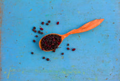 Dried hawthorn fruit in a wooden spoon Royalty Free Stock Image