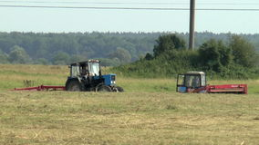 Dried hay tractor stock footage