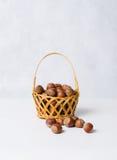Dried hazelnuts in basket Stock Photos