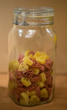 Dried heart-shaped pasta in a storage jar Royalty Free Stock Photography