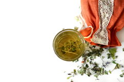 Dried Herb. Mix of bio herbal tea. Glass of tea with aromatic dry tea Stock Photo
