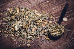 Dried herbal tea on spoon Royalty Free Stock Photos