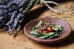 dried herbs on a ceramic plate stock photography