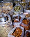 Dried Herbs. Closeup. A variety of dry herbs in plastic container bags. Stock Image royalty free stock photo