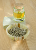 Dried herbs, cosmetic oil and organic soap Stock Images