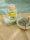 Dried herbs, cosmetic oil and organic soap Royalty Free Stock Image