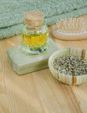 Dried herbs, cosmetic oil and organic soap Stock Photo