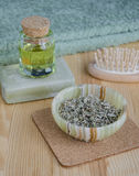 Dried herbs, cosmetic oil and organic soap Royalty Free Stock Photo