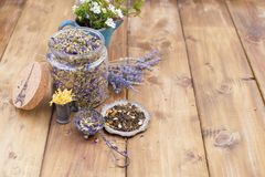 Dried herbs and flowers for tea. Wooden background and free space for text or cards. royalty free stock images