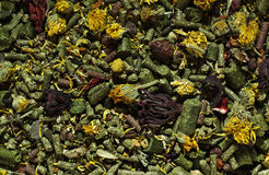 Dried herbs and pellets Stock Photo