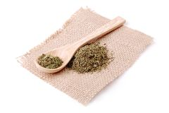 Dried herbs spices on a linen napkin in a wooden spoon Royalty Free Stock Image