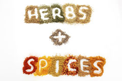 Dried herbs and spices. A mixture of different dried herbs and spices on a white background, spelling out the word 'herbs + spices Stock Images