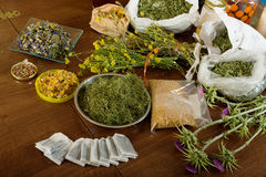 Dried herbs at table Royalty Free Stock Images