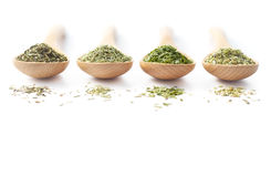 Dried Herbs on Wooden Spoons Stock Photo